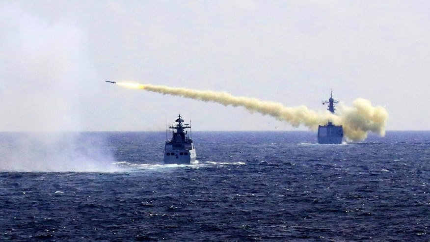 In this Monday, Aug. 1, 2016 photo released by Xinhua News Agency, a missile is launched from a navy ship during a live ammunition drill in the East China Sea.  China's navy has fired dozens of missiles and torpedoes during exercises in the East China Sea that come amid heightened maritime tensions in the region,  underscoring Beijing's determination to back up its sovereignty claims with force if needed.  The live-fire drills that began Monday follow China's strident rejection of an international arbitration panel's ruling last month that invalidated Beijing's claims to a vast swath of the South China Sea.  (Wu Dengfeng/Xinhua via AP)