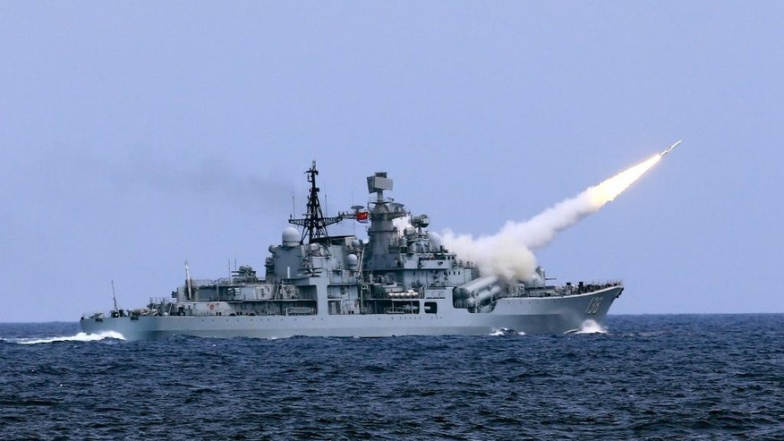 In this Aug. 1, 2016 photo released by Xinhua News Agency, a missile is launched from the guided-missile destroyer Taizhou during a live ammunition drill in the East China Sea. China's navy has fired dozens of missiles and torpedoes during exercises in the East China Sea that come amid heightened maritime tensions in the region. (Dai Zongfeng/Xinhua via AP)