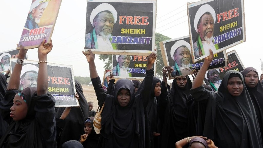 FILE- In this Friday April 1, 2016 file photo, Nigerian Shiite Muslims take to the street to protest and demanded the release of Shiite leader Ibraheem Zakzaky in Cikatsere, Nigeria. Nigeria's army gunned down 348 Shiites in an attack in which one soldier was killed, according to the report of a commission of inquiry published Monday, Aug. 1, 2016 which calls for all those involved in the killings to be prosecuted. (AP Photo/Sunday Alamba, file)