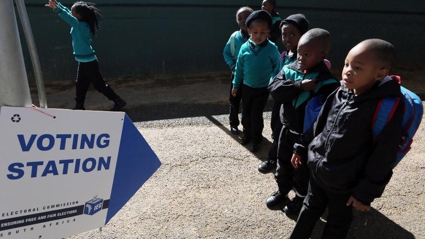 Children leave their school, which is being used as polling station, at the end of day in Johannesburg, Monday, Aug. 1, 2016. South Africa's ruling party faces a robust challenge in municipal elections on Wednesday from opposition groups seeking to capitalize on scandals linked to President Jacob Zuma. Early voting began Monday for the elderly, disabled and others unable to vote at their polling stations on election day. (AP Photo/Denis Farrell)