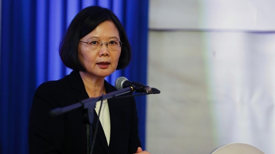 In this June 29, 2016 photo, Taiwan's President Tsai Ing-wen talks during a ceremony at the Gen. Andres Rodriguez school in Asuncion, Paraguay. Tsai on Monday, Aug. 1, 2016 apologized on behalf of the government to the island's aboriginal peoples for 400 years of conquest and colonization, saying the facing of difficult historical facts was necessary for society to move forward. (AP Photo/Jorge Saenz)