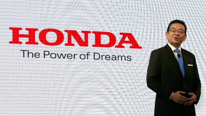 FILE - In this March 10, 2016 file photo, Honda Motor Co. President and Chief Executive Takahiro Hachigo speaks during a press conference  at the automaker's headquarters in Tokyo.  Honda is reporting a better-than-expected 174.6 billion yen profit ($1.7 billion) for the fiscal first quarter as it gradually recovers from plant damage caused by a quake in southwestern Japan. Analysts surveyed by FactSet had forecast at 133 billion yen ($1.3 billion) quarterly profit. The April-June 2016 profit fell 6 percent from a year ago, when the Japanese automaker earned 186 billion yen. Earlier this year, Honda sank into losses over a massive air-bag recall at its supplier Takata.  (AP Photo/Shizuo Kambayashi, File)