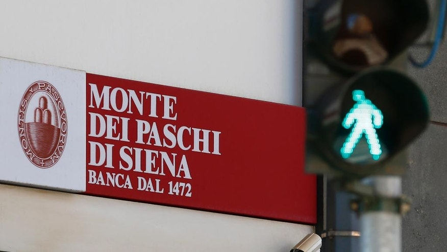 A view of a ' Monte Dei Paschi di Siena ' bank branch in Milan, Italy, Monday, Aug. 1, 2016. Shares in troubled Italian bank Monte dei Paschi di Siena have jumped as investors cheer a rescue deal from private investors that means the bank will not be nationalized. Monte dei Paschi was by far the worst performer in stress tests of 51 European banks but sought to head off any speculation about its future with the announcement late Friday of a 5 billion euro ($5.6 billion) capital injection from investors. (AP Photo/Antonio Calanni)