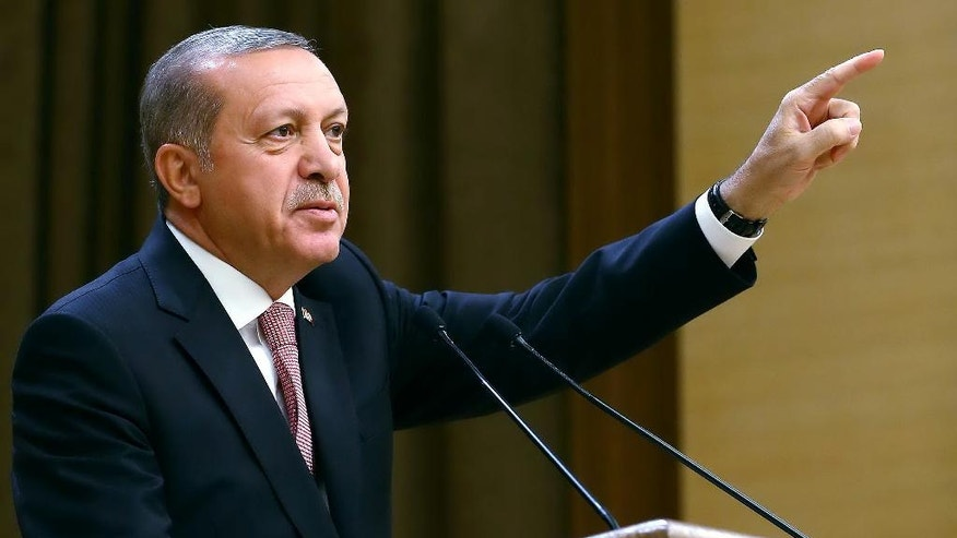 "Turkey's President Recep Tayyip Erdogan speaks during an event for foreign investors, in Ankara, Turkey, on Tuesday, Aug. 2, 2016. Erdogan said, once more blasted unnamed Western countries which he says supported an attempted coup on July 15 which left more than 270 people dead. ""The West is supporting terrorism and taking sides with coups."" (Kayhan Ozer/Presidential Press Service, Pool Photo via AP)"