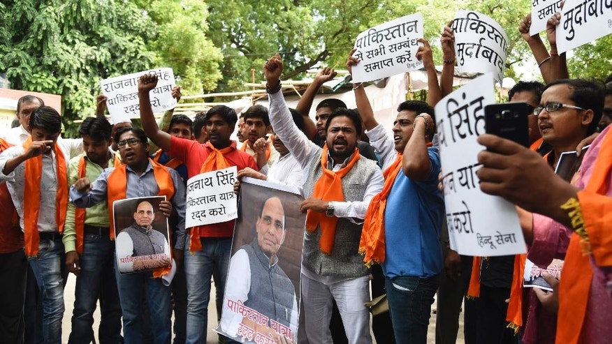 Activists of Hindu Sena or Hindu Army protest against Indian Home Minister Rajnath Singh over his upcoming visit to Pakistan, in New Delhi, India, Tuesday, Aug. 2, 2016. The protesters, who propagate an extremely ultra Hindu nationalist view, demand that India cut off all ties with Pakistan. (AP Photo/Thomas Cytrynowicz)