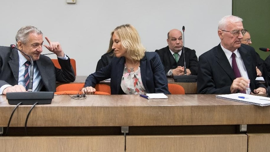 Former head of the Yugoslavia's secret service Zdravko Mustac, left, and his former subordinate Josip Perkovic, right, sit in the courtroom in Munich,Germany, Wednesday, Aug. 3, 2016. The court has convicted them of involvement in the 1983 killing of a Communist-era dissident, and sentenced them to life in prison. (Peter Kneffel/dpa via AP)