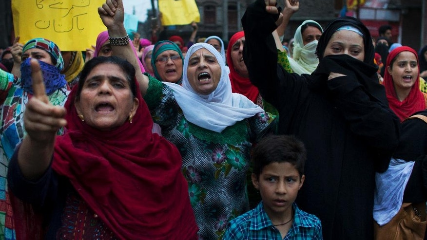 Kashmiri Muslim women shout anti Indian slogans during in a protest march organized by women separatist group Dukhtaran-e-milat, or Daughters of the Nation, shortly after a day long curfew in Srinagar, Indian controlled Kashmir, Tuesday, Aug. 2, 2016. The protesters shouted slogans against Indian rule and denounced the killings of Kashmiri civilians during the recent unrest. (AP Photo/Dar Yasin)