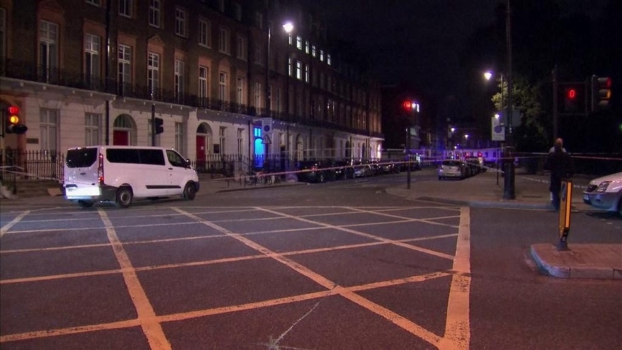 The area where a knife attack happened is cordon off in London Thursday, Aug. 4, 2016. London police say a woman has died and others were injured in a knife attack in a central part of the city. (Sky News via AP)