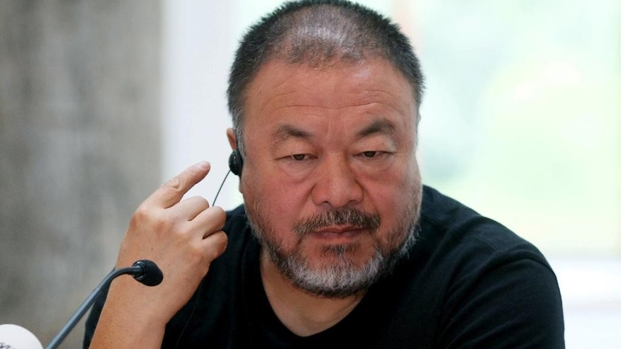 FILE - In this July 13, 2016 file photo, Chinese artist and activist Ai Weiwei speaks during a press conference at the exhibition 'translocation - transformation' at the Museum of contemporary art in Vienna, Austria. Trials started this week of Chinese lawyers and legal rights activists who were detained in July last year and charged with subversion for their attempts to bring attention to abuses and demand government accountability. Fengrui Law Firm has pursued numerous sensitive cases and represented outspoken critics of the ruling Communist Party. Ai hired Fengrui in 2011, when he was slapped with a $2.4 million tax evasion suit that was widely seen as an attempt to intimidate him into silence on political issues. (AP Photo/Ronald Zak, File)