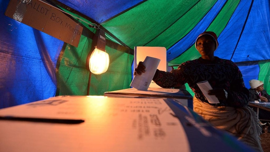 A woman casts her vote at a polling station in Atteridgeville, Pretoria, South Africa, Wednesday Aug. 3, 2016. South Africans are voting in municipal elections in which the ruling African National Congress seeks to retain control of key metropolitan areas despite a vigorous challenge from opposition parties. (AP Photo)