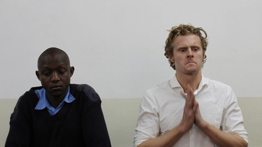 A British national Jack Alexander Wolf Marrian appears at Kibera Law Court in Nairobi, Kenya Thursday, Aug. 4, 2016. Kenyan police have charged Marrian with trafficking nearly 100 kilograms (220 pounds) of cocaine that was impounded last week at the country's main seaport. (AP Photo/Khalil Senosi)