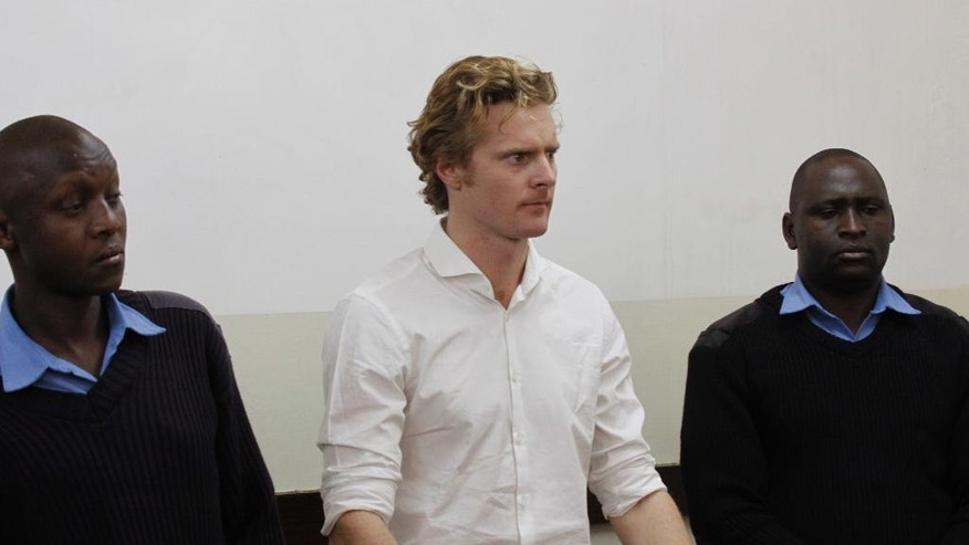 A British national Jack Alexander Wolf Marrian appears at Kibera Law Court in Nairobi, Kenya Thursday, Aug. 4, 2016. Kenyan police have charged Marrian with trafficking nearly 100 kilograms (220 pounds) of cocaine that was impounded last week at the country's main seaport.(AP Photo/Khalil Senosi)
