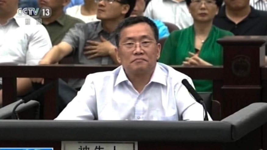 In this image from video, Zhou Shifeng sits for his trial at the Tianjin No. 2 Intermediate People's Court in northern China's Tianjin Municipality Thursday, Aug. 4, 2016. Zhou, a Chinese lawyer was in court Thursday in the third of a series of subversion trials demonstrating the ruling Communist Party's determination to shut down independent human rights activists and government critics. (CCTV via AP Video)