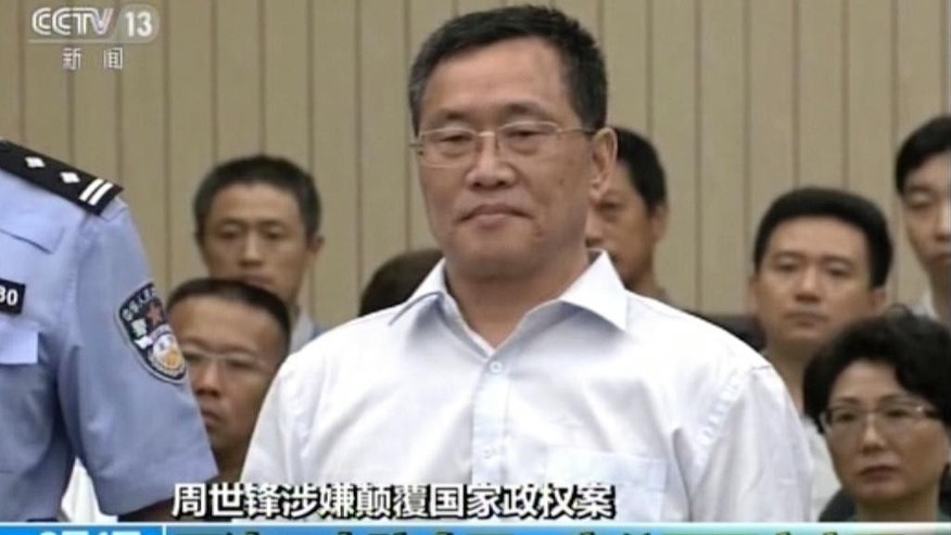 In this image taken from video and made available via AP Video, Zhou Shifeng arrives for his trial at the Tianjin No. 2 Intermediate People's Court in northern China's Tianjin Municipality on Thursday, Aug. 4, 2016. Zhou, a Chinese lawyer, was in court Thursday in the third of a series of subversion trials demonstrating the ruling Communist Party's determination to shut down independent human rights activists and government critics. (CCTV via AP Video)
