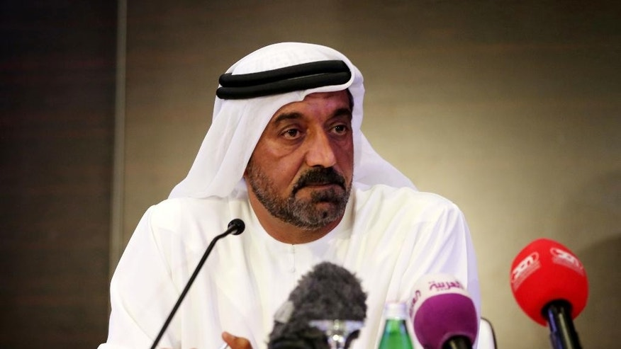 Sheikh Ahmed bin Saeed Al-Maktoum, chairman and CEO of Emirates, listens to a reporter's question on Wednesday, Aug. 3, 2016. An Emirates flight from India with 300 people on board crash landed at Dubai's main airport Wednesday, sending black smoke billowing into the air and halting all flights at the Middle East's busiest airport. (AP Photo/Adam Schreck)