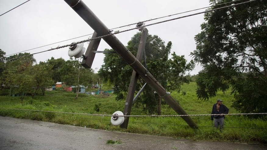 Power lines collapsed by Hurricane Earl hinder traffic on the road from Flores, in Peten, the northern Guatemalan border state with Belize, Thursday, Aug. 4, 2016. Earl deteriorated to a weak tropical storm Thursday as it passed over northern Guatemala en route to southern Mexico. (AP Photo/Luis Soto)