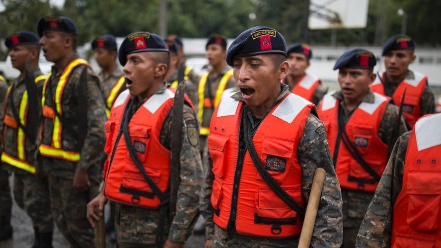 Guatemalan army soldiers sing  as they stand for review at their base, before the arrival of Hurricane Earl in Puerto Barrios, Guatemala, Tuesday, Aug. 3, 2016. Hurricane Earl bore down on the coast of the Caribbean nation of Belize with the danger of high surf and winds, while also threatening neighboring Guatemala and southern Mexico with torrential rains. (AP Photo/Luis Soto)