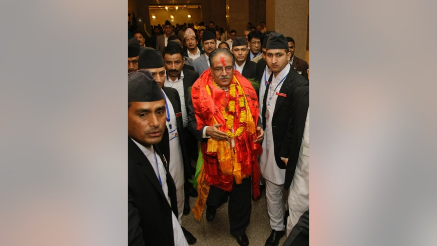 Nepal's newly-appointed prime minister Pushpa Kamal Dahal, center, comes out of the parliament after being elected in Kathmandu, Nepal, Wednesday, Aug.3, 2016. Nepal's parliament elected the former communist rebel leader as the country's new prime minister Wednesday who would now lead a coalition government and likely give continuation to political instability in the Himalayan nation. (AP Photo/Bikram Rai)