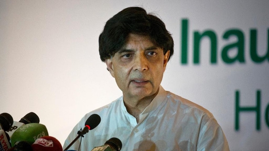 Pakistani Interior Minister Chaudry Nisar Ali Khan addresses a news conference in Islamabad, Pakistan, Thursday, Aug. 4, 2016. Khan says his country was open to dialogue with arch-rival India but with dignity and respect. Without naming India, he said no country could suppress a freedom movement and attack ???unarmed??? people in the name of terrorism. (AP Photo/B.K. Bangash)