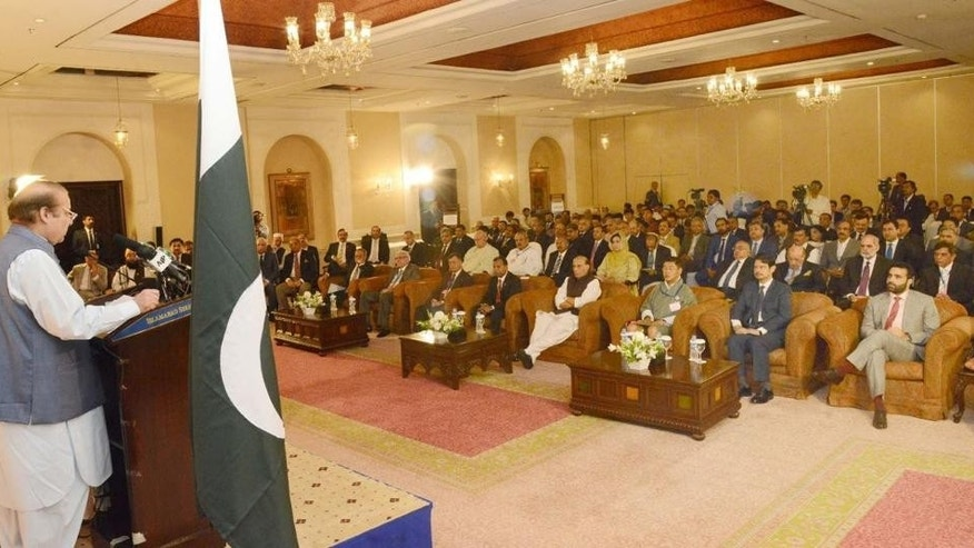In this photo release by Pakistan's Press Information Department, Pakistan's Prime Minister Nawaz Sharif, left,  speaks at  a conference of SAARC countries on peace and cooperation in Islamabad, Pakistan, Thursday, Aug. 4, 2016. Hundreds of Pakistani's have rallied in the capital, Islamabad, against the imminent visit of India's interior minister, Rajnath Singh. (Press Information Department via AP)