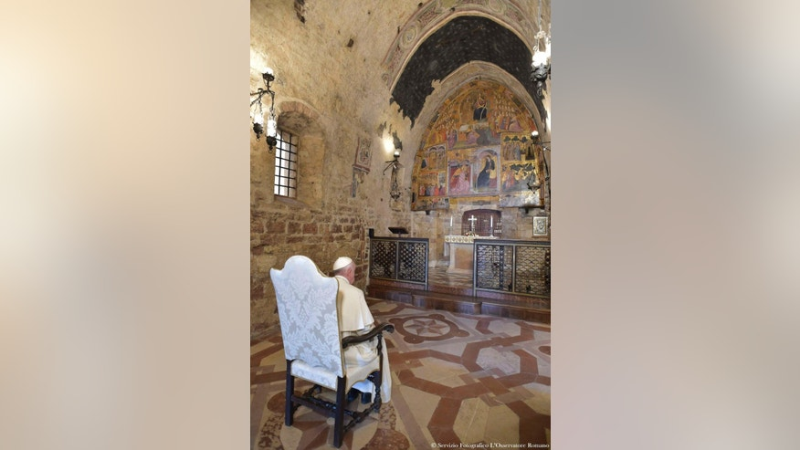Pope Francis prays inside the St. Maria of Angels Basilica in Assisi, Italy, Thursday, aug. 4, 2016. Francis called on followers to offer forgiveness to those who wrong them during a pilgrimage to his namesake's hometown marking the 800th anniversary of the Feast of Pardon initiated by St. Francis. The pope traveled briefly to Assisi on Thursday to pray at tiny church within the basilica that is considered the cradle of the Franciscan order. (L'Osservatore Romano/Pool Photo via AP)