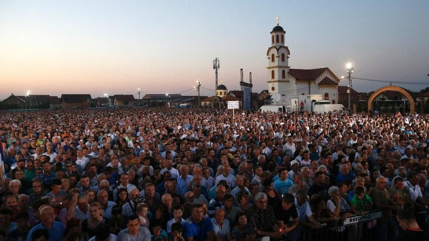 "People attend a memorial service for the victims of the Croatian ""Storm"" offensive, to mark the 21th anniversary in the village of Busije, some 25 kilometers (15 miles) west of Belgrade, Serbia, Thursday, Aug. 4, 2016. Croatia is marking its military operation with victory celebrations, while Serbia considers the ""Storm"" offensive a war crime that resulted in the exodus of most Serbs living in Croatia. (AP Photo/Darko Vojinovic)"