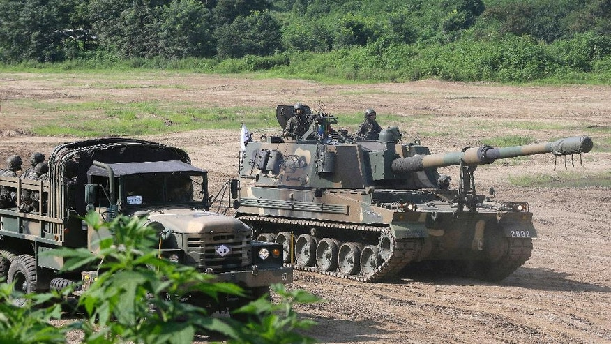 South Korea's army K-9 self-propelled artillery vehicle moves during an exercise in Paju, South Korea, near the border with North Korea, Thursday, Aug. 4, 2016. A medium-range ballistic missile fired Wednesday by North Korea flew about 1,000 kilometers (620 miles) and landed near Japan's territorial waters, Seoul and Tokyo officials said, one of the longest flights by a North Korean missile. (AP Photo/Ahn Young-joon)