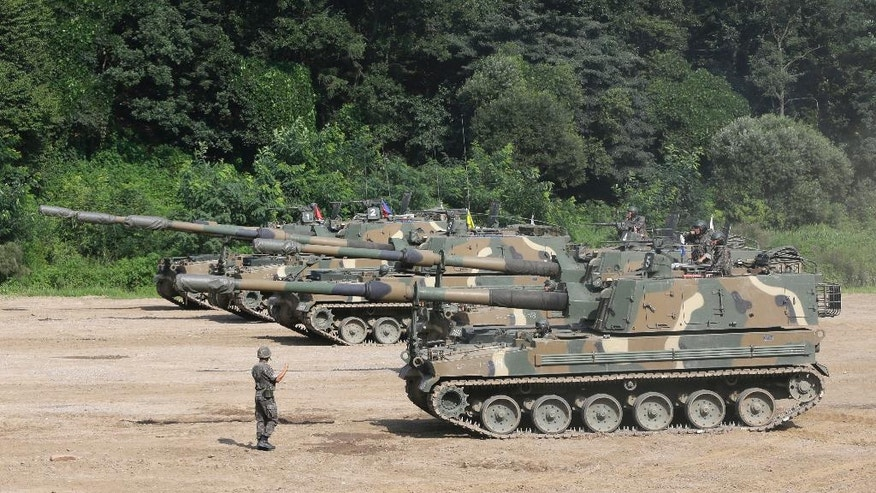 South Korea's army K-9 self-propelled artillery vehicles take positions during an exercise in Paju, South Korea, near the border with North Korea, Thursday, Aug. 4, 2016. A medium-range ballistic missile fired Wednesday by North Korea flew about 1,000 kilometers (620 miles) and landed near Japan's territorial waters, Seoul and Tokyo officials said, one of the longest flights by a North Korean missile. (AP Photo/Ahn Young-joon)