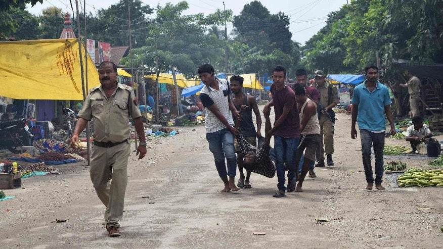 People carry a body after rebels opened fire in a crowded market at Kokrajhar, in the north-eastern Indian state of Assam, India, Friday, Aug. 5, 2016. Dozens of rebel groups have been fighting the government and sometimes each other for years in seven states in northeast India. They demand greater regional autonomy or independent homelands for the indigenous groups they represent. (AP Photo)
