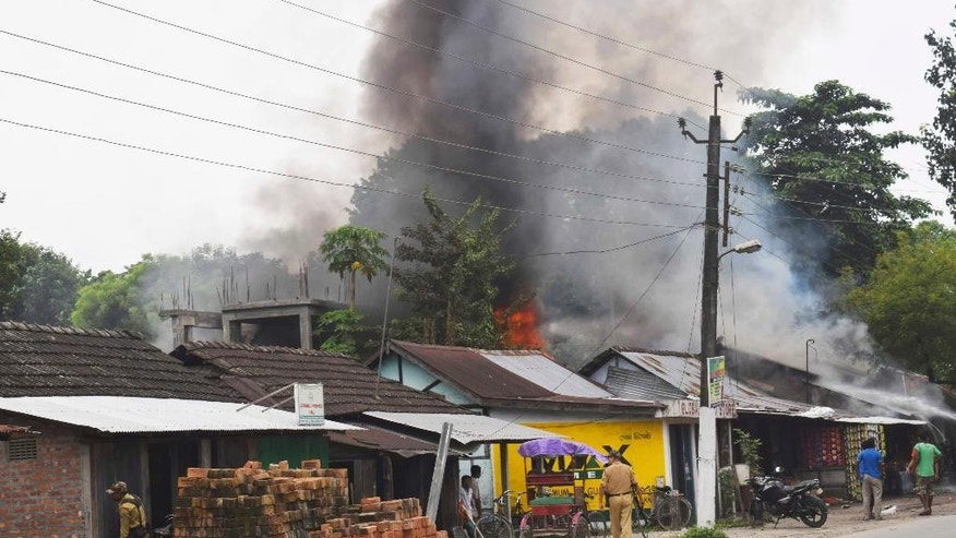 A fire burns after rebels opened fire in a crowded market at Kokrajhar, in the north-eastern Indian state of Assam, India, Friday, Aug. 5, 2016. Dozens of rebel groups have been fighting the government and sometimes each other for years in seven states in northeast India. They demand greater regional autonomy or independent homelands for the indigenous groups they represent. (AP Photo)