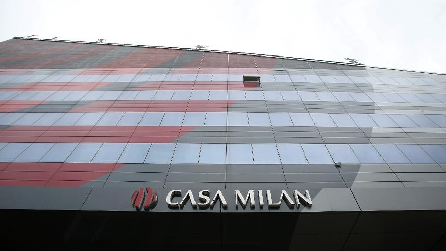 A view of the AC Milan soccer team headquarters in Milan, Italy, Friday, Aug. 5, 2016. Silvio Berlusconi has signed a deal to sell his full stake in the soccer club AC Milan to Chinese investors, yet another entry into European soccer by cash-rich Chinese firms. Berlusconi's Fininvest investment arm said Friday that the deal with a Chinese investment group values the club at 740 million euros and requires the investors to spend 350 million euros over three years on improvements. (AP Photo/Antonio Calanni)