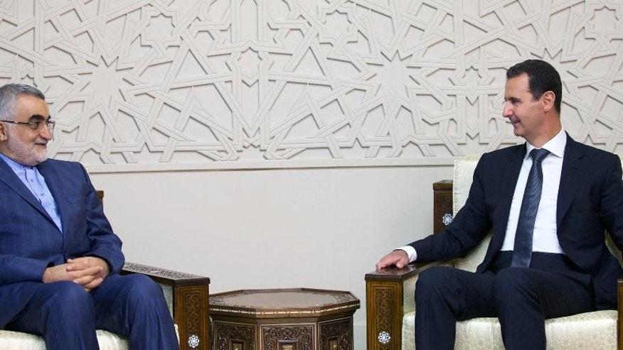 "In this photo released by the Syrian official news agency SANA, Syrian President Bashar Assad, right, meets with Alaeddin Boroujerdi, Chairman of the Committee for Foreign Policy and National Security at the Iranian Shura Council, in Damascus, Syria, Thursday, Aug 4, 2016. Boroujerdi said operation by the Syrian government and allied forces in Aleppo aims to ""liberate"" tens of thousands of residents from the grip of what he called terrorist groups. (SANA via AP)"
