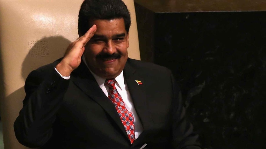 President Nicolas Maduro salutes the UN General Assembly after his address on September 29, 2015.