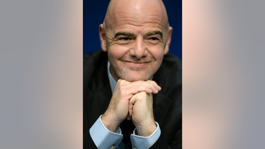 FILE - In this March 18, 2016 file photo  FIFA-President Gianni Infantino smiles during a press conference after the FIFA executive meeting at the FIFA headquarters in Zurich, Switzerland, Friday, March 18, 2016. FIFA's ethics committee has cleared Infantino of alleged misconduct relating to use of private flights. FIFA ethics prosecutors say their decision to end a formal investigation into alleged conflicts of interest and improperly accepting gifts was supported by FIFA ethics judges. (Walter Bieri/Keystone via AP, file)