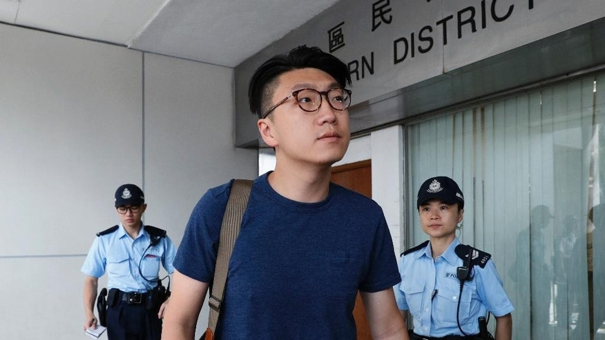 Hong Kong localist leader Edward Leung Tin-kei arrives a court after being charged with rioting in Hong Kong, Friday, Aug. 5, 2016. Amid a dispute over candidates excluded on political grounds, Hong Kong's government on Friday posted the names of those approved to run in the territory's most contentious Legislative Council elections since reverting to Chinese rule almost two decades ago. (AP Photo/Kin Cheung)