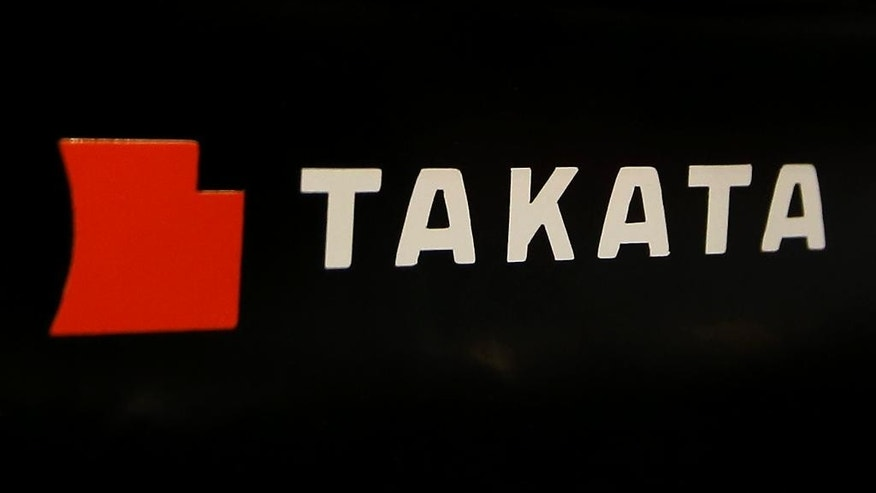 In this July 6, 2016 photo, the logo of Takata Corp. is seen at an auto-supply shop in Tokyo.  Takata Corp., the Japanese company at the center of a massive global air bag recall, is sticking to its forecast of posting a 13 billion yen ($129 million) profit for the fiscal year through March.  It reported on Friday, Aug. 5, 2016,  an April-June profit of 2 billion yen ($19.8 million), down 33 percent from the same period the previous year, as quarterly sales slipped 7 percent to 169 billion yen ($1.7 billion). (AP Photo/Shizuo Kambayashi)