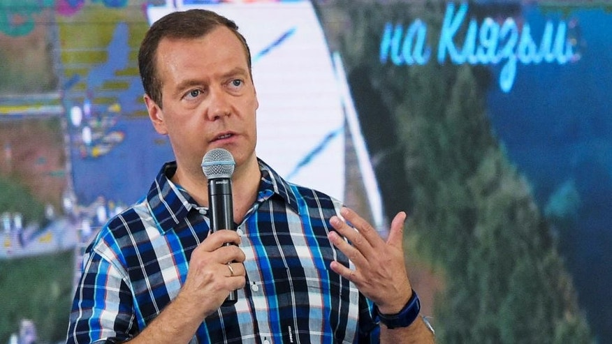 In this Tuesday, Aug. 2, 2016 photo Russian Prime Minister Dmitry Medvedev addresses a youth forum in Vladimir region, Russia. More than 160,000,  people have signed a petition on Friday Aug. 5, 2016 calling on President Vladimir Putin to sack Medvedev. The petition lamented the poor performance of the government and said a man like Medvedev should not lead the Cabinet. (Alexander Astafyev/Sputnik, Government Press Service Pool Photo via AP)