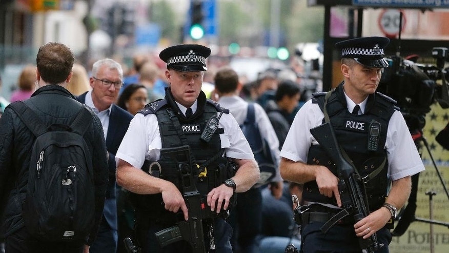 Police guard Russell Square following a knife attack in London, Thursday, Aug. 4, 2016. Terrorism is being examined as a potential motive for a knife rampage at Russell Square, central London, that left one woman dead and five others injured. (AP Photo/Frank Augstein)