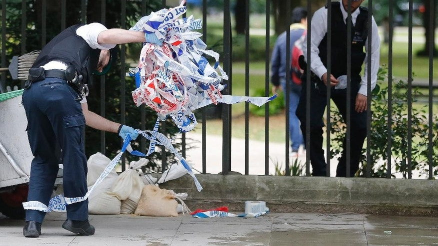 Police clear barricade tape from Russell Square in London, Thursday, Aug. 4, 2016. Terrorism is being examined as a potential motive for a knife rampage at Russell Square, central London, that left one woman dead and five others injured. (AP Photo/Frank Augstein)