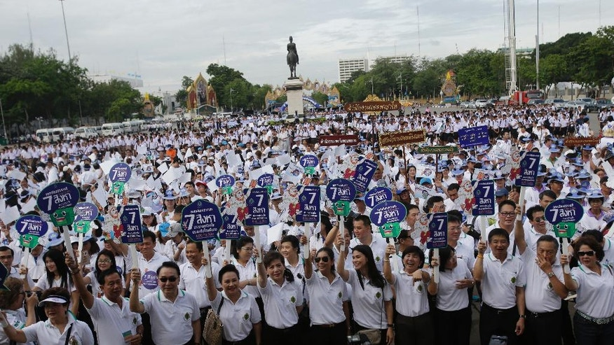 FILE - In this Thursday, Aug. 4, 2016, file photo, government workers attend a rally to encourage people to vote in the upcoming referendum polling day in Bangkok, Thailand. On Sunday, Thailand is holding a referendum on a new constitution drafted by the military government with none of the trappings of democracy: no rallies, no campaigns and virtually no debate. After all, the new constitution, if approved, would allow the junta to keep it in control for several years and enshrine a watered-down democracy. (AP Photo/Sakchai Lalit, File)