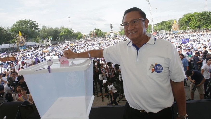 In this Thursday, Aug. 4, 2016, photo, Thailand's Election Commission Chairman Supachai Somcharoen demonstrates casting a ballot during a rally to encourage people to vote ahead of the upcoming referendum in Bangkok, Thailand. On Sunday, Thailand is holding a referendum on a new constitution drafted by the military government with none of the trappings of democracy: no rallies, no campaigns and virtually no debate. After all, the new constitution, if approved, would allow the junta to keep it in control for several years and enshrine a watered-down democracy. (AP Photo/Sakchai Lalit)