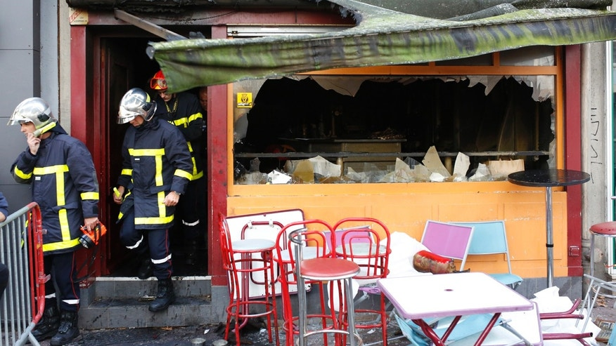 Firefighters leave the bar where a fire broke in Rouen, western France, Saturday Aug.6, 2016. A fire swept through a Friday night birthday party at a bar in the Normandy city of Rouen, killing at least 13 people and injuring six others, French authorities said. (AP Photo/Kamil Zihnioglu)