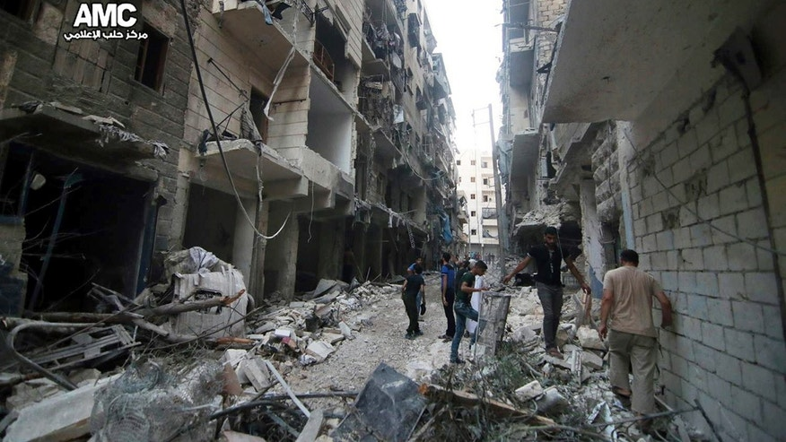 July 29, 2016: Syrian citizens inspect damaged buildings after airstrikes hit Aleppo, Syria