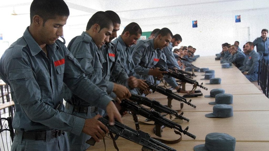 FILE - In this Sunday, July 24, 2016 file photo, Afghan police soldiers practice, in Lashkargah, capital of southern Helmand province, Afghanistan. A new elite Taliban force is proving its strength in the strategic southern province of Helmand, pointing to the insurgents' ability to refine their battlefield techniques to match Afghanistan's increasingly professional national army. (AP Photos/Abdul Khaliq)
