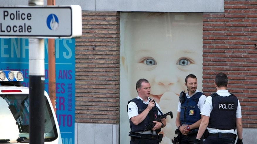 "Police secure the scene, at the police headquarters in Charleroi, Belgium on Saturday, Aug. 6, 2016.  Two female officers were attacked and wounded by a man wielding a machete and shouting ""Allahu Akhbar"" outside a police station in the Belgian city of Charleroi on Saturday, police said.  (AP Photo/Virginia Mayo)"