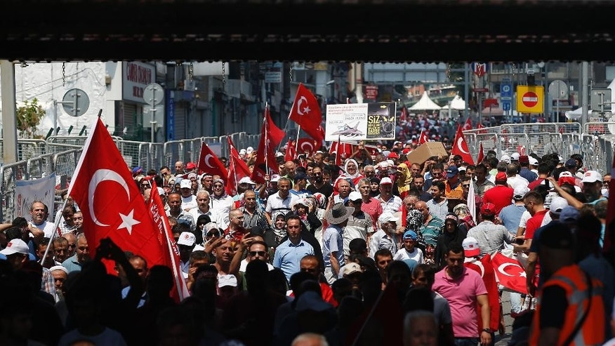 People arrive for a Democracy and Martyrs' Rally in Istanbul, Sunday, Aug. 7, 2016. Crowds are gathering in Istanbul for a massive rally to mark the end of nightly democracy demonstrations following Turkey's abortive July 15 coup that killed over 270 people. (AP Photo/Emrah Gurel)