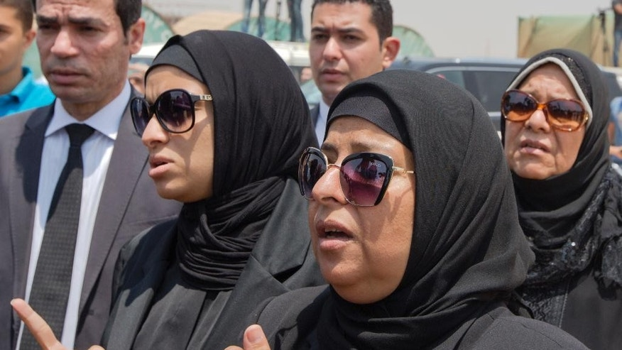 Relatives of Egyptian-American Nobel Laureate Ahmed Zewail grieve during a public funeral ceremony at the site of a science academy founded by Zewail, in 6th of October city, near Cairo, Egypt, Sunday, Aug. 7, 2016. Egypt bid farewell to Ahmed Zewail, who won a Nobel Prize in 1999, according him a military funeral with full honors led by President Abdel-Fattah el-Sissi. Zewail, was a science adviser to President Obama who won the 1999 Nobel Prize for his work on the study of chemical reactions over immensely short time scales. (AP Photo/Amr Nabil)