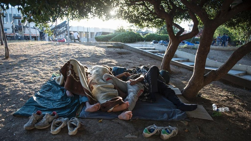 "Migrants sleep in a park, at the northern Greek city of Thessaloniki, on Saturday, July 9, 2016. With Turkey in crisis and Europe's borders closed, smugglers in northern Greece are looking forward to a profitable summer. Police say traffickers are using increasingly sophisticated methods _ with motorcycle spotters, ""blind spot"" maps in border surveillance, and even police informants to move refugees stuck here for months in limbo. (AP Photo/Giannis Papanikos)"