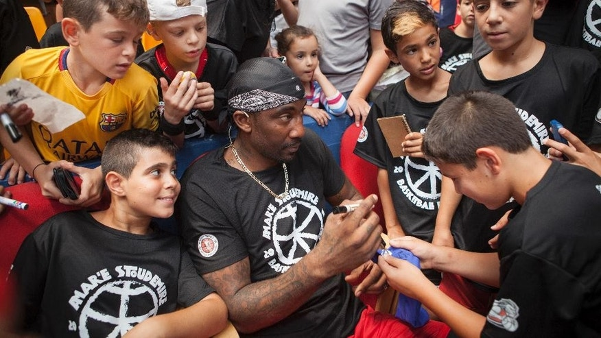 Recently retired NBA star Amare Stoudemire signs autographs in Jerusalem, Monday, Aug. 8, 2016. Stoudemire signed a two-year contract Monday to play for Israeli team Hapoel Jerusalem. Stoudemire hosted some 140 Jewish and Arab kids to his basketball peace camp on Monday as he prepared to join the Israeli league. (AP Photo/Dan Balilty)