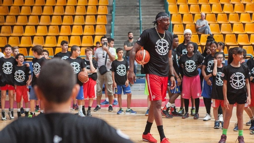 Recently retired NBA star Amare Stoudemire trains kids in Jerusalem, Monday, Aug. 8, 2016. Stoudemire signed a two-year contract Monday to play for Israeli team Hapoel Jerusalem. Stoudemire hosted some 140 Jewish and Arab kids to his basketball peace camp on Monday as he prepared to join the Israeli league. (AP Photo/Dan Balilty)